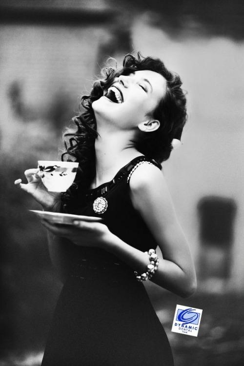 elegant woman smiling drinking tea